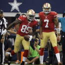 San Francisco 49ers tight end Vernon Davis (85) and quarterback Colin Kaepernick (7) celebrate a touchdown in the first half of an NFL football game against the Dallas Cowboys, Sunday, Sept. 7, 2014, in Arlington, Texas The Associated Press