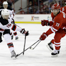 New Jersey Devils' Travis Zajac (19) breaks a stick while Carolina Hurricanes' Brett Bellemore (73) defends during the first period of an NHL hockey game in Raleigh, N.C., Saturday, April 5, 2014 The Associated Press