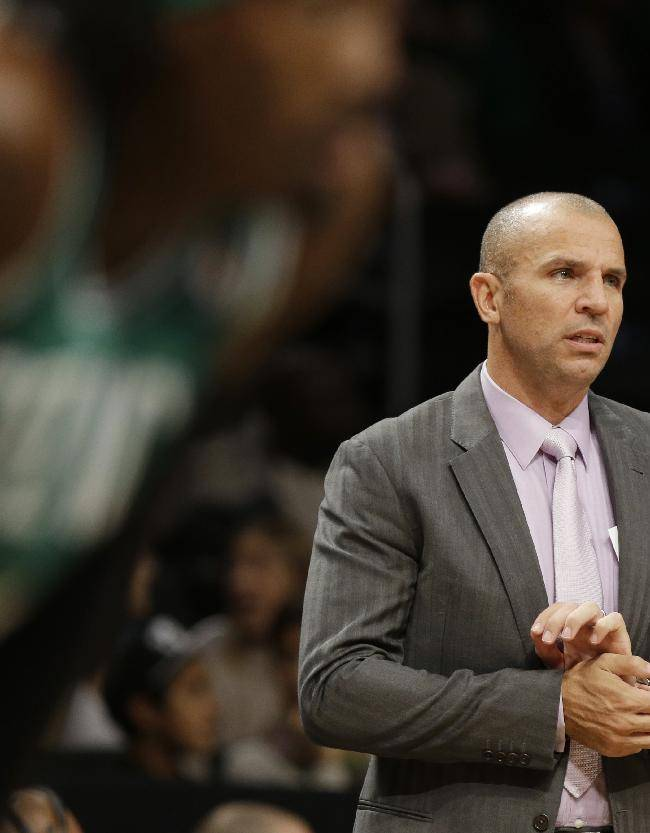 Brooklyn Nets head coach Jason Kidd watches his team play during the first half of a preseason NBA basketball game against the Boston Celtics Tuesday, Oct. 15, 2013, in New York