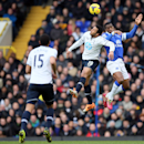 Tottenham's Mousa Dembele, centre, jumps for the ball with Everton's Sylvain Distin during the English Premier League soccer match between Tottenham Hotspur and Everton at the White Hart Lane stadium in London, Sunday, Feb. 9 2014