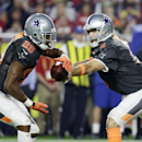Dallas Cowboys' Tony Romo hands off to Dallas Cowboys' DeMarco Murray during the first half of the NFL Football Pro Bowl Sunday, Jan. 25, 2015, in Glendale, Ariz The Associated Press