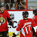 Ottawa Senators forward Matt Puempel (26) celebrates his goal against the Toronto Maple Leafs with forwards David Legwand (17) and Bobby Ryan (6) during the second period of an NHL preseason hockey game in Ottawa, Ontario, on Wednesday, Sept. 24, 2014. Th