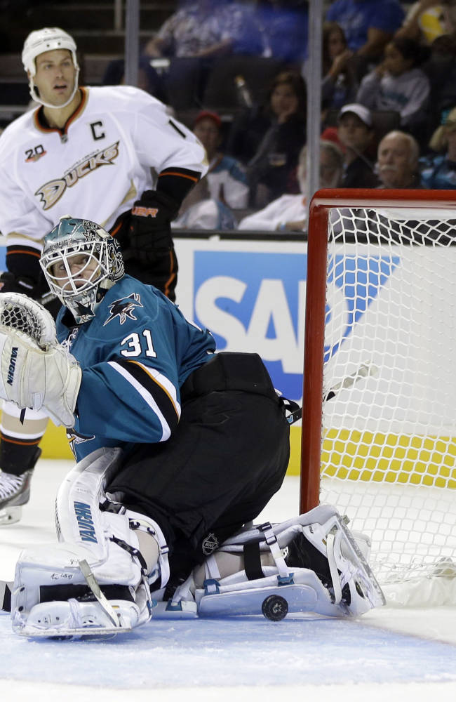 San Jose Sharks goalie Antti Niemi (31), of Finland, is beaten for a goal by Anaheim Ducks' Corey Perry, not pictured, during the second period of a preseason NHL hockey game on Friday, Sept. 20, 2013, in San Jose, Calif