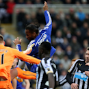 Chelsea's Didier Drogba, center, scores his goal past Newcastle United's goalkeeper Jak Alnwick, left, during their English Premier League soccer match at St James' Park, Newcastle, England, Saturday Dec. 6, 2014