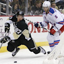 Pittsburgh Penguins' Sidney Crosby (87) gets a pass off from behind the net in front of New York Rangers' Dan Girardi (5) during the second period of an NHL hockey game in Pittsburgh, Sunday, Jan. 18, 2015 The Associated Press