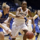 Oklahoma State's Toni Young, right, and DePaul's Katherine Harry (51) chase a loose ball during the second half of a first-round game in the women's NCAA college basketball tournament in Durham, N.C., Sunday March 24, 2013. Oklahoma State won 73-56. (AP Photo/Gerry Broome)