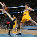 Utah Jazz forward Gordon Hayward, left, collides with Denver Nuggets forward Jan Vesely, of the Czech Republic, while driving the lane for a shot in the fourth quarter of the Nuggets' 101-94 victory in an NBA basketball game in Denver on Saturday, April 1