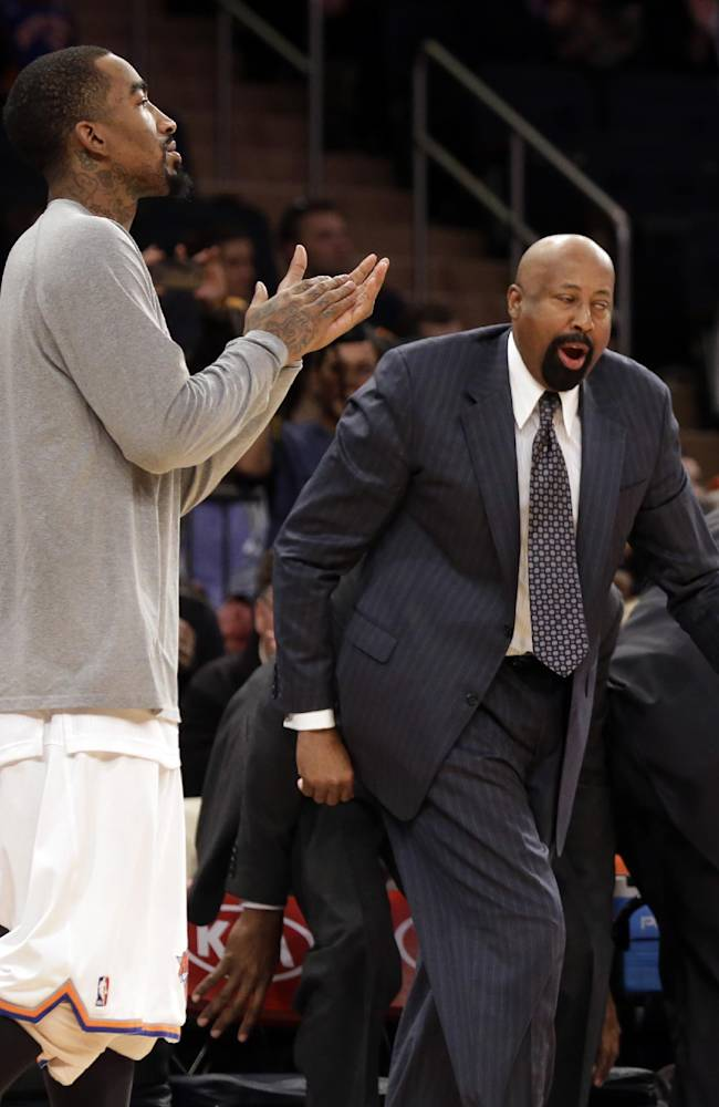 New York Knicks coach Mike Woodson, right, and guard J.R. Smith, celebrate after the Knicks' 115-94 victory over the Milwaukee Bucks in an NBA basketball game at New York's Madison Square Garden, Saturday, March 15, 2014