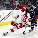 Columbus Blue Jackets' Jack Johnson, right, checks Detroit Red Wings' Tomas Jurco, of Slovakia, in the first period of an NHL hockey game in Columbus, Ohio, Tuesday, March 11, 2014. (AP Photo/Paul Vernon)