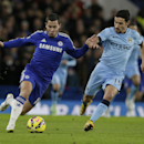 Chelsea's Eden Hazard, left, competes for the ball with Manchester City's Jesus Navas during the English Premier League soccer match between Chelsea and Manchester City at Stamford Bridge, London, England, Saturday, Jan. 31, 2015