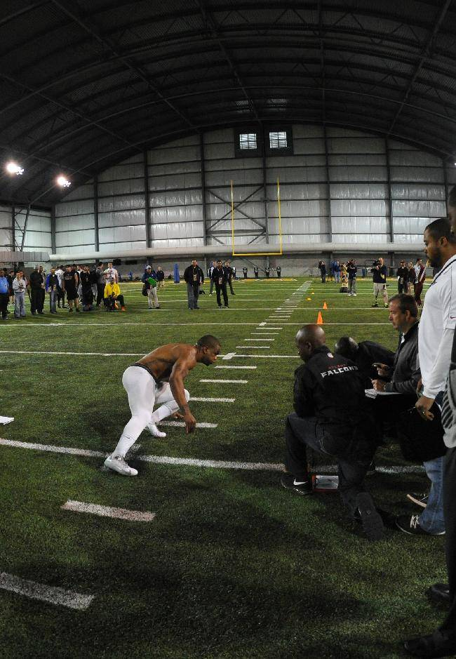 Scouts watch Georgia Tech NCAA college football cornerback Louis Young during NFL pro day Friday, March 28, 2014, in Atlanta