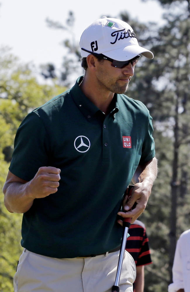 Adam Scott, of Australia, punches the air after making par on the 18th hole during the first round of the Masters golf tournament Thursday, April 10, 2014, in Augusta, Ga