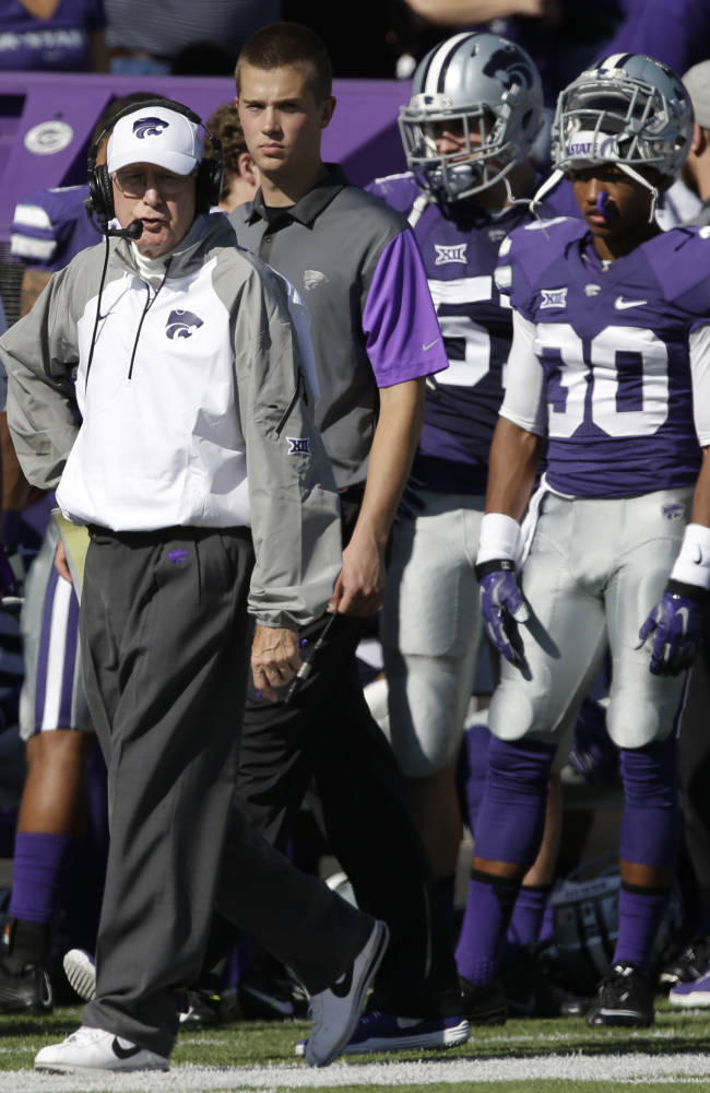 Kansas State head coach Bill Snyder paces the sidelines during the first half of an NCAA college football game against Texas in Manhattan, Kan., Saturday, Oct. 25, 2014