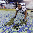 In this Feb. 2, 2014, file photo, Seattle Seahawks' Michael Bennett celebrates with confetti on the field after the Seahawks beat the Denver Broncos in the NFL Super Bowl XLVIII football game, in East Rutherford, N.J. The Seahawks announced Monday, March