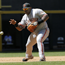 San Francisco Giants third baseman Pablo Sandoval barehands a ground ball hit by Arizona Diamondbacks' Martin Prado during the fourth inning of a baseball game on Thursday, April 3, 2014, in Phoenix The Associated Press