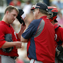 Washington Nationals relief pitcher Drew Storen, left, talks with pitching coach Steve McCatty in the seventh inning of a spring exhibition baseball game against the Atlanta Braves, Tuesday, March 4, 2014, in Kissimmee, Fla. The Braves won 8-4 The Associa