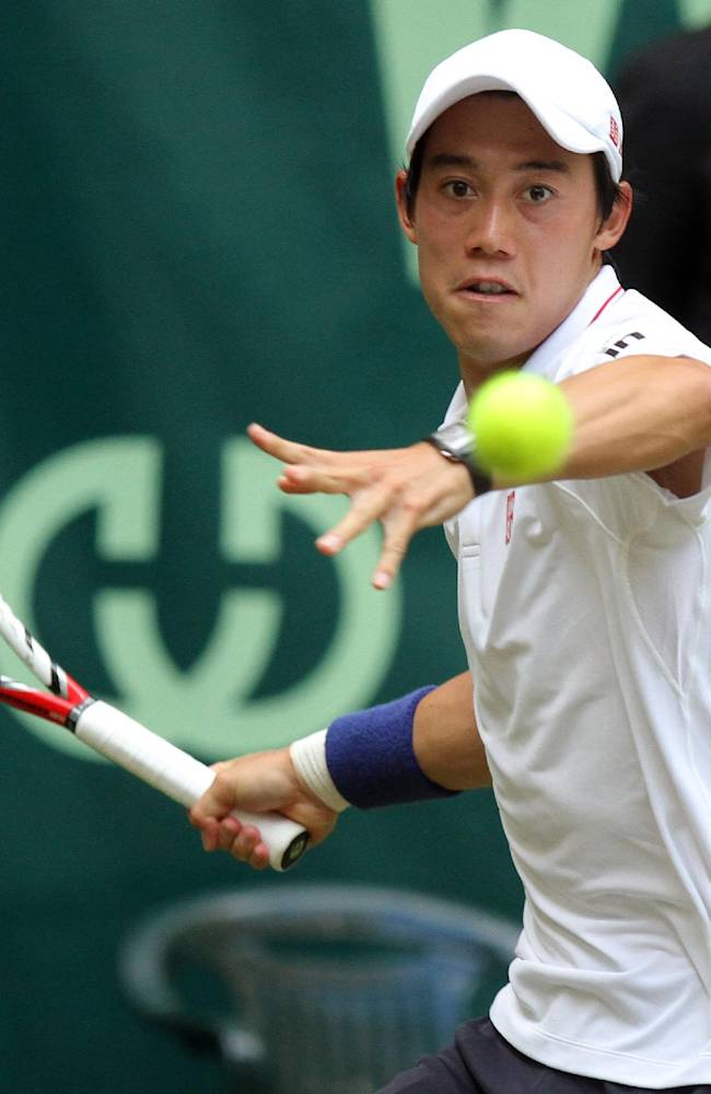 Japan's Kei Nishikori returns a shot to Steve Johnson from the US during their quarterfinal match at the Gerry Weber Open tennis tournament in Halle, Germany, Friday, June 13, 2014. Nishikori won the match with 6-1 and 6-7