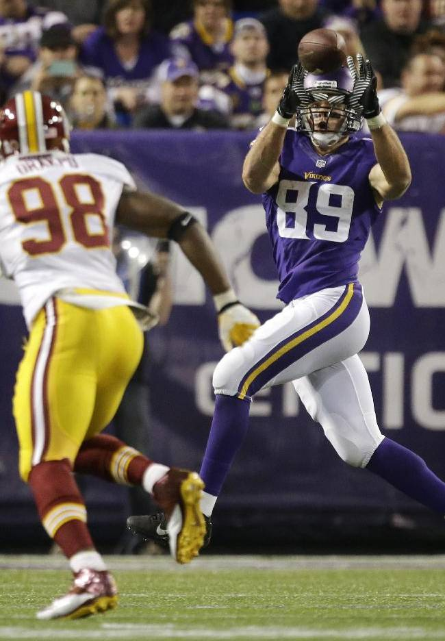 Minnesota Vikings tight end John Carlson (89) catches a touchdown pass in front of Washington Redskins outside linebacker Brian Orakpo (98) during the second half of an NFL football game Thursday, Nov. 7, 2013, in Minneapolis