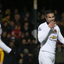 Manchester United's Robin Van Persie, right, looks back at teammate Manchester United's Radamel Falcao after missing a chance on goal during their English FA Cup fourth round soccer match between Cambridge United and Manchester United, in Cambridge, Engla