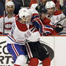 Montreal Canadiens left wing Michael Bournival (49) battles for the puck against Chicago Blackhawks right wing Patrick Kane (88) during the second period of a preseason NHL hockey game in Chicago, Wednesday, Oct. 1, 2014 The Associated Press