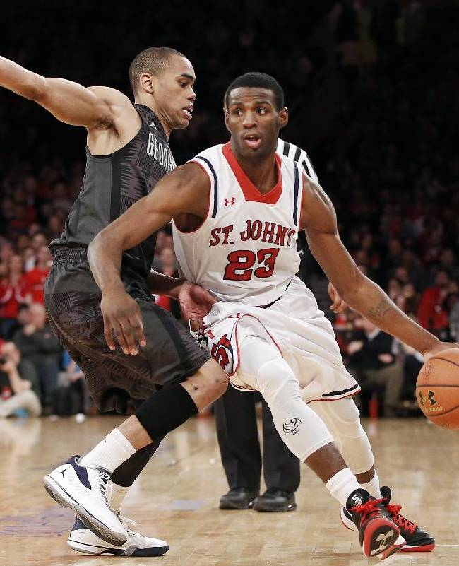 St. John's guard Rysheed Jordan (23) drives past Georgetown guard Markel Starks during the second half of an NCAA college basketball game at Madison Square Garden in New York, Sunday, Feb. 16, 2014. Jordan scored 24 points as St. John's won 82-60