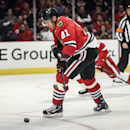 Chicago Blackhawks' Marian Hossa carries the puck in the first period against the Detroit Red Wings in an NHL exhibition hockey game in Chicago on Tuesday, Sept. 23, 2014. The Associated Press