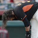 San Francisco Giants' Brandon Crawford leans over after striking out to end the fourth inning against the Arizona Diamondbacks in a spring exhibition baseball game on Sunday, March 2, 2014, in Scottsdale, Ariz The Associated Press