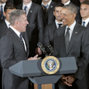 President Barack Obama talks with team manager Peter Vermes, and members of the Sporting Kansas City soccer team during a ceremony in the East Room of the White House in Washington, Wednesday, Oct. 1, 2014, where he honored the 2013 Major League Soccer ch