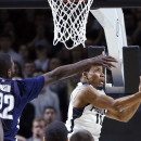 Providence guard Bryce Cotton (11) glides for a reverse layup against Villanova forward JayVaughn Pinkston (22) during the first overtime of an NCAA basketball game in Providence, Tuesday, Feb. 18, 2014. Villanova won 82-79 in double overtime The Associat