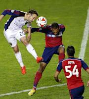 Real Salt Lake midfielder Ned Grabavoy, left, battles for a header with Chicago Fire midfielder Matt Watson, center, while midfielder Benji Joya, right, looks on during the second half of an MLS soccer game on Saturday, May 3, 2014, at Toyota Park in Bridgeview, Ill. (AP Photo/Kamil Krzaczynski)