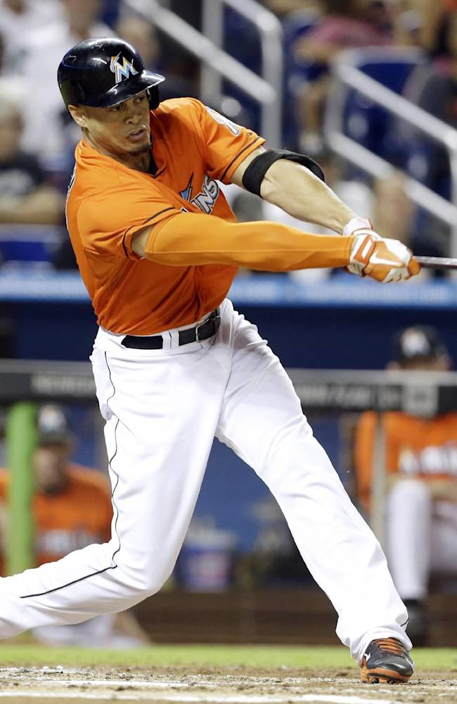 Miami Marlins' Giancarlo Stanton hits an RBI single in the first inning of a baseball game against the Atlanta Braves, Wednesday, Sept. 11, 2013, in Miami
