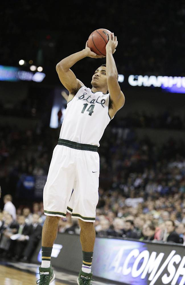 Michigan State's Gary Harris (14) shoots a jump shot during the third-round game of the NCAA men's college basketball tournament against Harvard in Spokane, Wash., Saturday, March 22, 2014