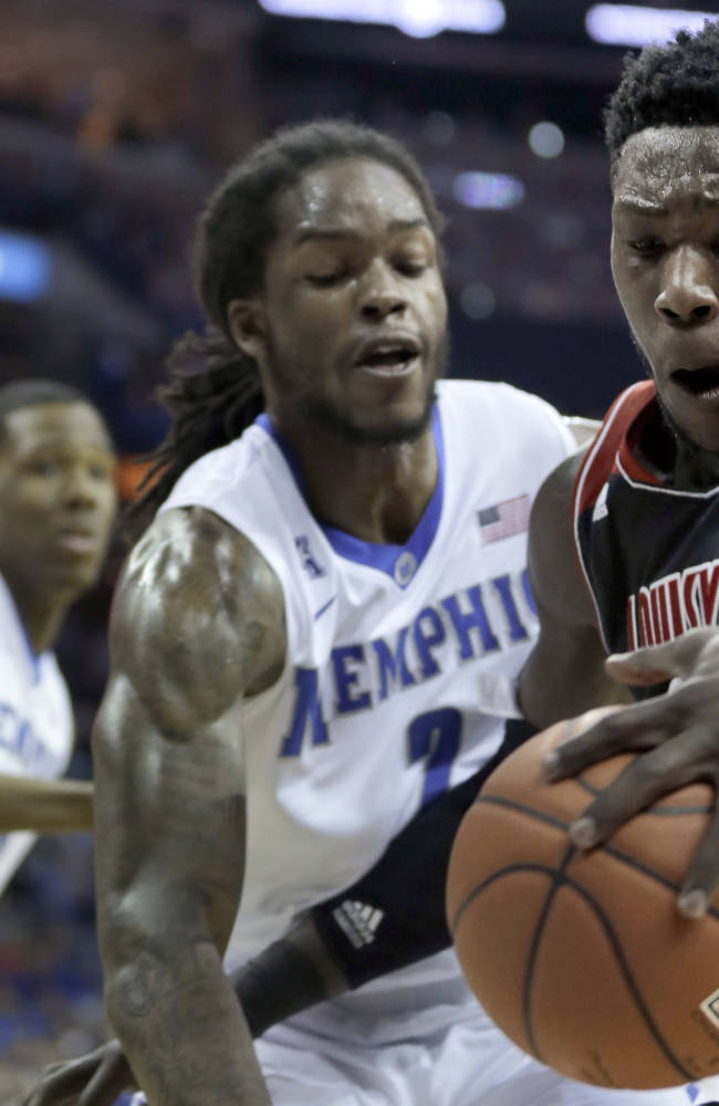 Louisville's Montrezl Harrell, right, is pressured by Memphis' Shaq Goodwin, center, in the first half of an NCAA college basketball game in Memphis, Tenn., Saturday, March 1, 2014