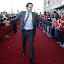 Chicago Blackhawks defenseman Duncan Keith greets fans as he arrives at the United Center before an NHL hockey game against the Buffalo Sabres in Chicago, Saturday, Oct. 11, 2014 The Associated Press