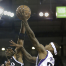 Sacramento Kings guard Isaiah Thomas, right, drives to the basket Brooklyn Nets guard Jason Terry, during the fourth quarter of an NBA basketball game in Sacramento, Calif., Wednesday, Nov. 13, 2013. The Kings won 107-86 The Associated Press