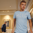 Manchester City Football Club striker Edin Dzeko, right, and manager Manuel Pellegrini leave a news conference after speaking to the media in New York, Tuesday, July 29, 2014, in advance of Wednesday's Guinness International Champions Cup soccer match aga