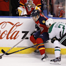 Florida Panthers right wing Scottie Upshall (19) and Dallas Stars left wing Antoine Roussel (21) fight for the puck during the third period of an NHL hockey game in Sunrise, Fla., Sunday, April 6, 2014 The Associated Press