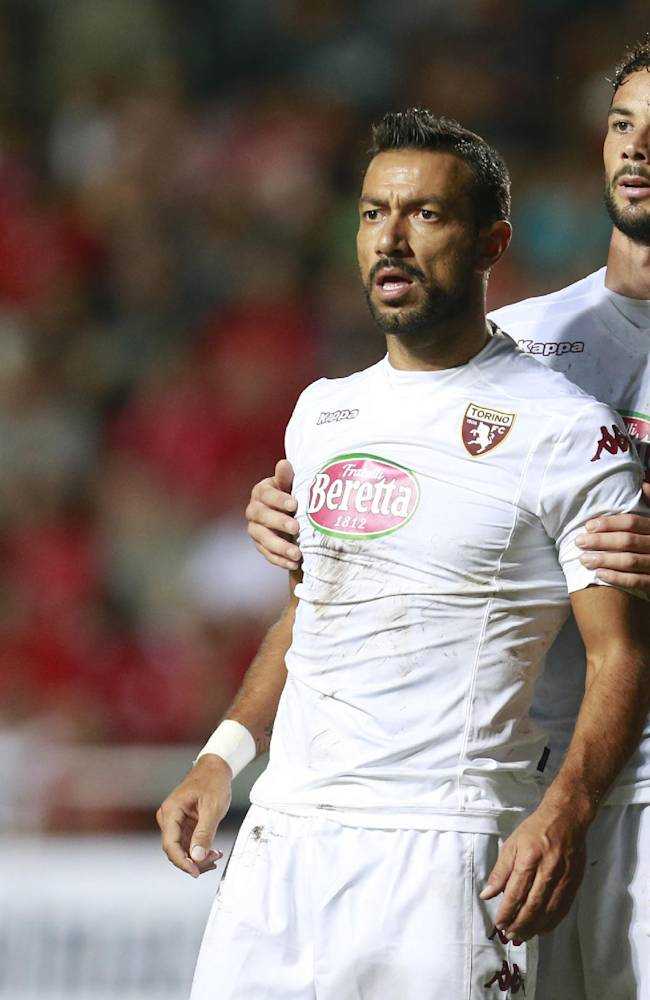 Torino's Fabio Quagliarella, left and Marcelo Larrondo stand on the pitch during the Europa League play-off soccer match between Torino and Split, in Dugopolje, Croatia, Thursday, Aug. 21, 2014