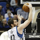 Minnesota Timberwolves' Kevin Love pulls in a rebound in the first quarter of an NBA basketball game against the Brooklyn Nets, Friday, Nov. 22, 2013, in Minneapolis. Love had a double-double with 17 points and 16 rebounds in the Timberwolves' 111-81 win