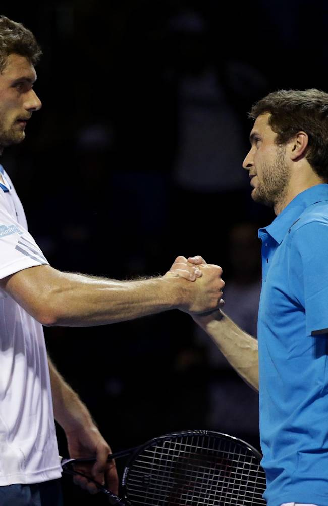 Gilles Simon of France is congratulated by Daniel Brands of Germany after their first round match at the Australian Open tennis championship in Melbourne, Australia, Tuesday, Jan. 14, 2014