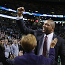 Doc Rivers, former head coach of the Boston Celtics and current head coach of the Los Angeles Clippers, acknowledges cheering fans as he enters the TD Garden floor for his first time back, before an NBA basketball game in Boston, Wednesday, Dec. 11, 2013