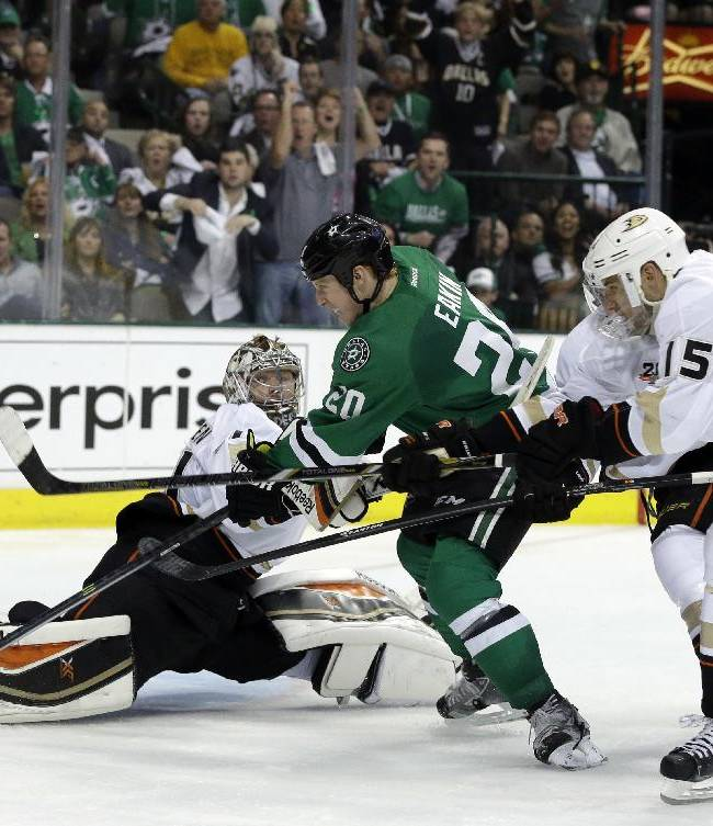 Anaheim Ducks goalie Frederik Andersen (31) of Denmark defends against a shot by Dallas Stars' Cody Eakin (20) as the Ducks' Ryan Getzlaf (15) helps against the prssure in the third period of Game 3 of a first-round NHL hockey Stanley Cup playoff series game, Monday, April 21, 2014, in Dallas