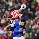 Sunderland's Fabio Borini, top vies for the ball with Everton's Gareth Barry, bottom, during their English Premier League soccer match at the Stadium of Light, Sunderland, England, Saturday, April 12, 2014