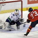 Vancouver Canucks goalie Eddie Lack (31), of Sweden, blocks a shot by Florida Panthers' Brandon Pirri (73) during a shootout of an NHL hockey game on Sunday, March 16, 2014, in Sunrise, Fla. The Canucks won 4-3. (AP Photo/Luis M. Alvarez)