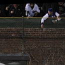 Arizona Diamondbacks center fielder Tony Campana misses a ball hit for a double by Chicago Cubs' Luis Valbuena during the third inning of a baseball game in Chicago, Tuesday, April 22, 2014. Chicago won 9-2 The Associated Press