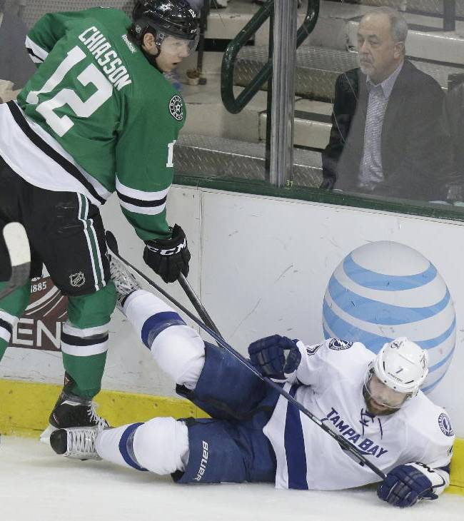 Tampa Bay Lightning defenseman Radko Gudas (7) is knocked to the ice by Dallas Stars right wing Alex Chiasson (12) during the second period of an NHL hockey game Saturday, March 1, 2014, in Dallas