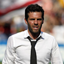 D.C. United head coach Ben Olsen walks of the field after an MLS soccer match against the New York Red Bulls, at RFK Stadium, Sunday, Aug. 31, 2014, in Washington. United won 2-0 The Associated Press