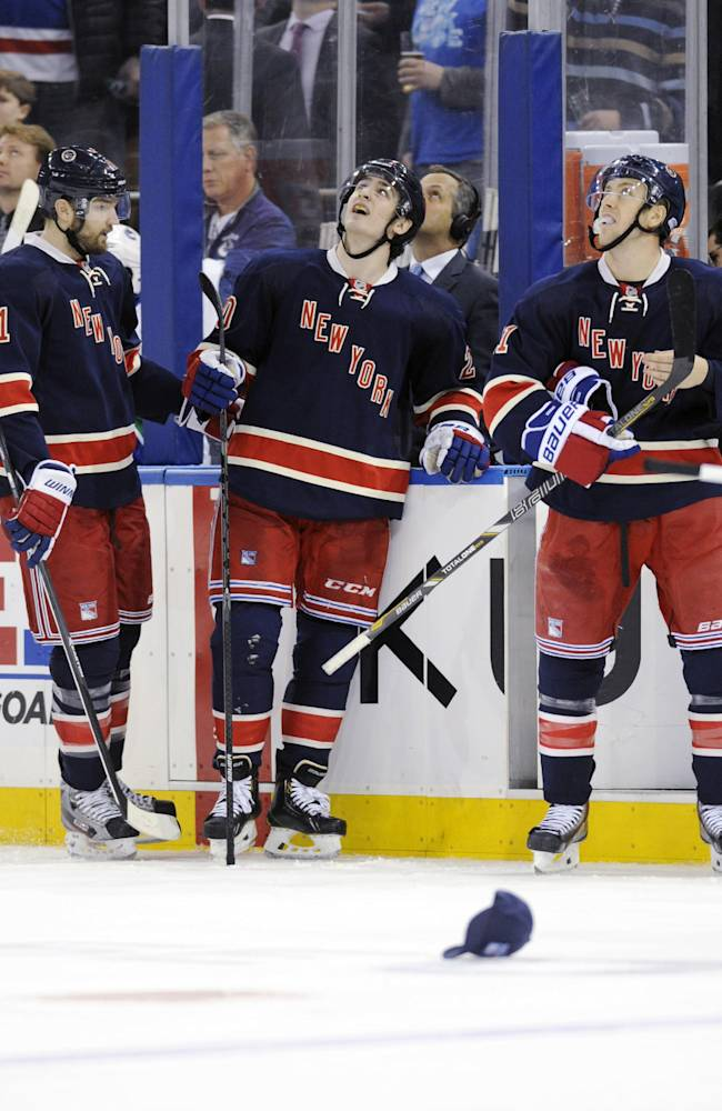 New York Rangers' Chris Kreider, center, looks up at the video board after scoring during the third period of an NHL hockey game against the Vancouver Canucks Saturday, Nov. 30, 2013, at Madison Square Garden in New York. It was Kreider's third goal for a hat trick as the Rangers won 5-2