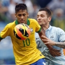 Brazil's Neymar, left, fights for the ball with France's Mathieu Debuchy, right, during a friendly soccer match in Porto Alegre, Brazil, Sunday, June 9, 2013. (AP Photo/Andre Penner)
