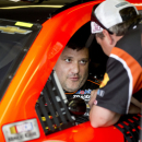 NASCAR driver Tony Stewart talks with a crew member during practice for Sunday's NASCAR auto race at Atlanta Motor Speedway in Hampton, Ga., Friday, Aug. 29, 2014. Sunday's race will be his first since his car struck and killed a fellow driver during a sprint race in New York three weeks ago. (AP Photo/John Bazemore)